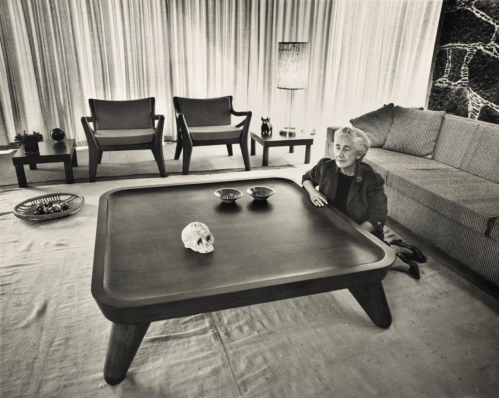 Clara Porset with the chairs and table she based on an ancient Totonac sculpture, circa 1952