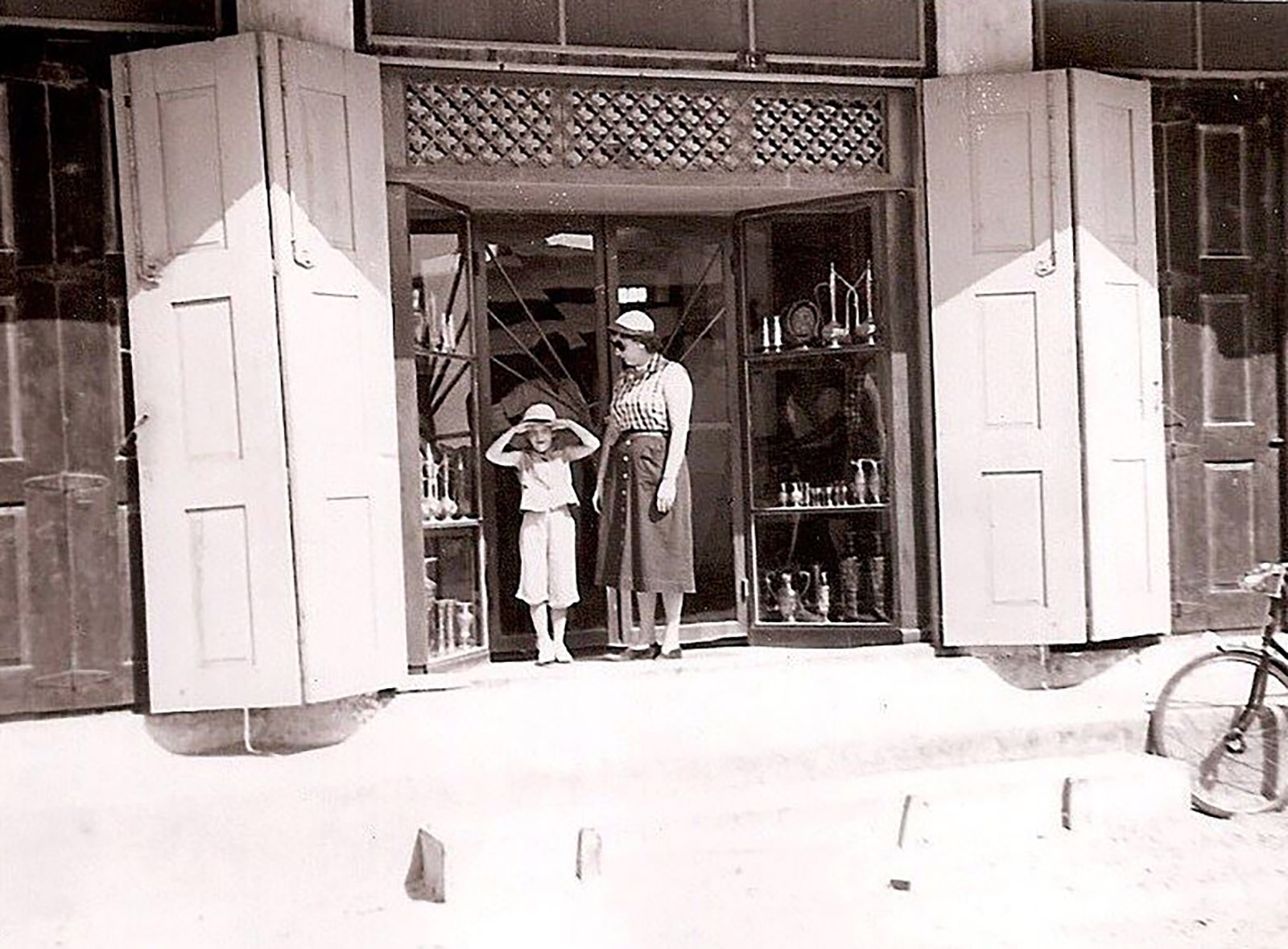 The author's mother and grandmother in front of a shop in Al Khobar, Saudi Arabia, early 1950s