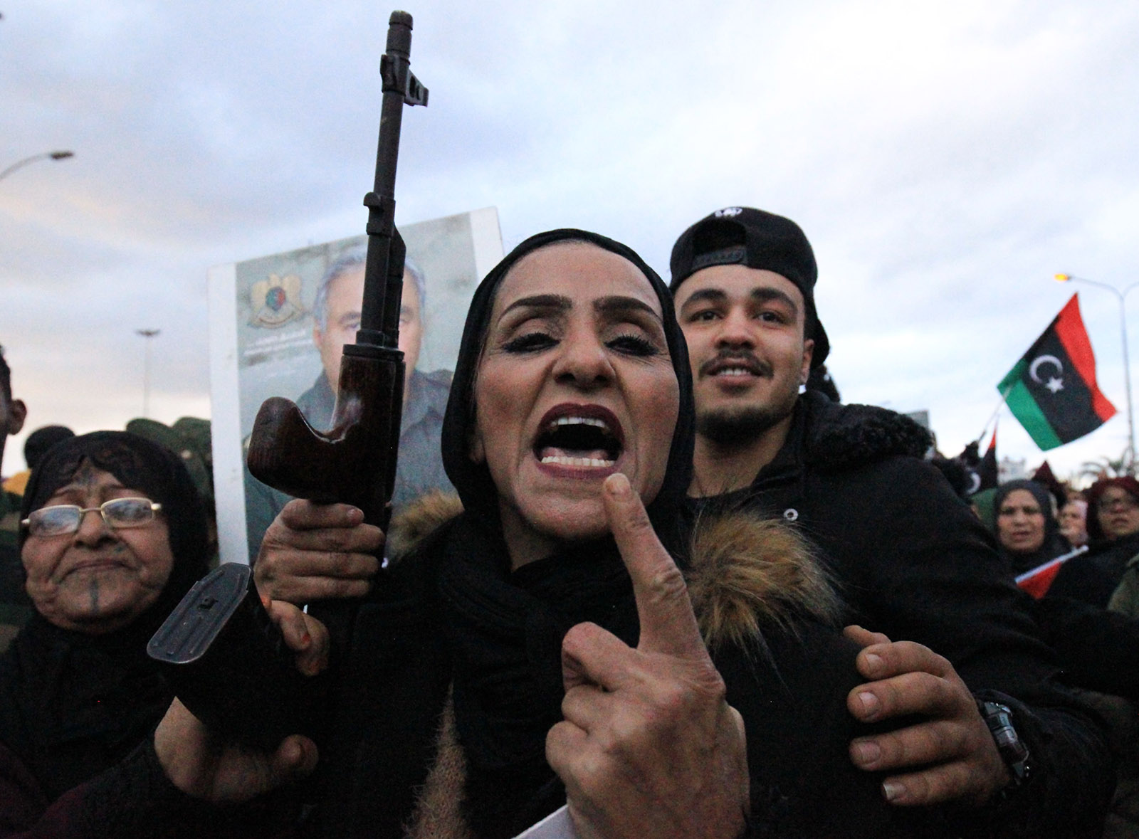 A Libyan woman brandishing a rifle at a protest in Benghazi