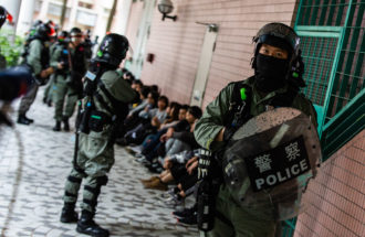 Police in riot gear rounding up suspected protesters, Hong Kong, January 5, 2020
