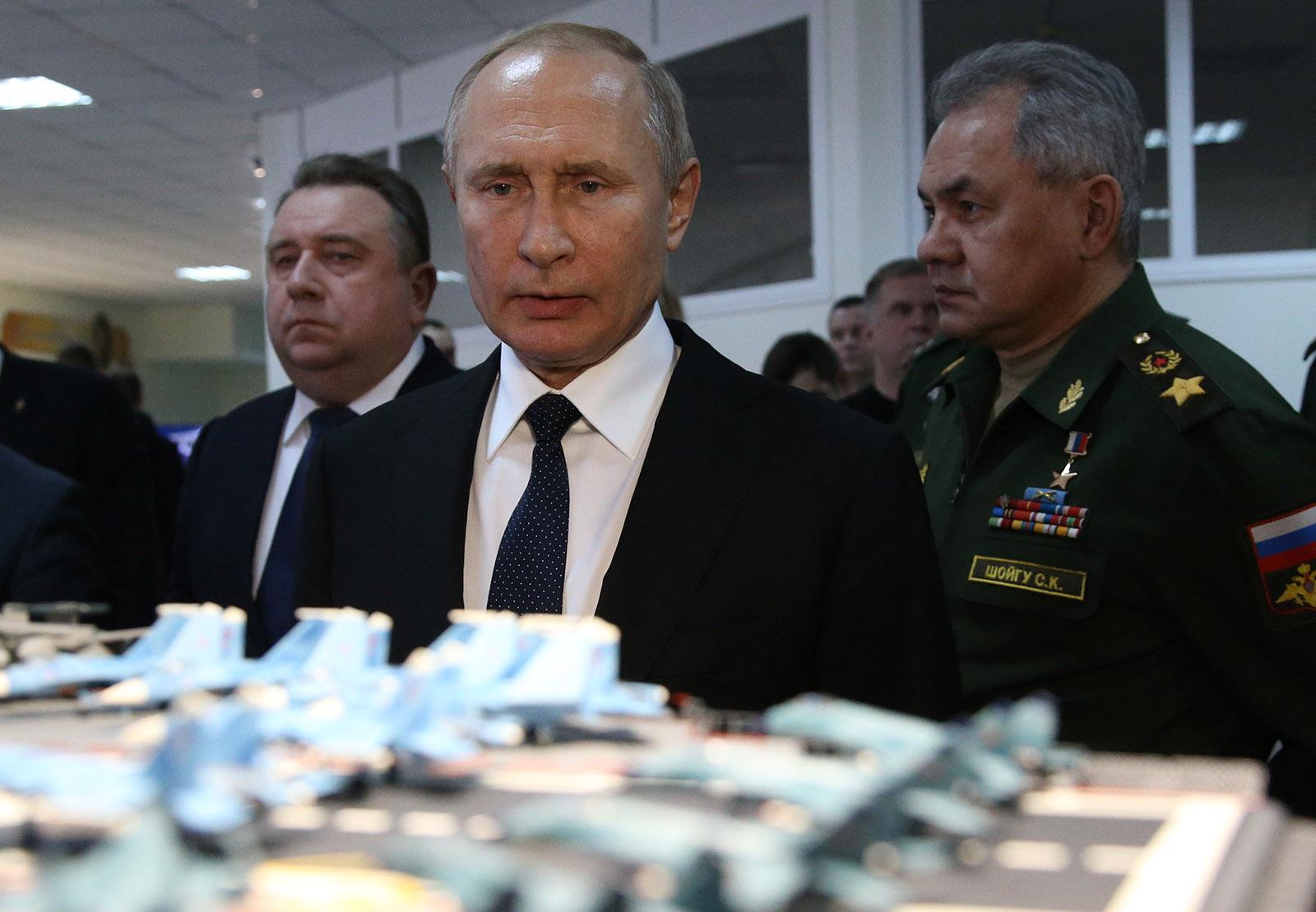 Putin examining a model aircraft carrier