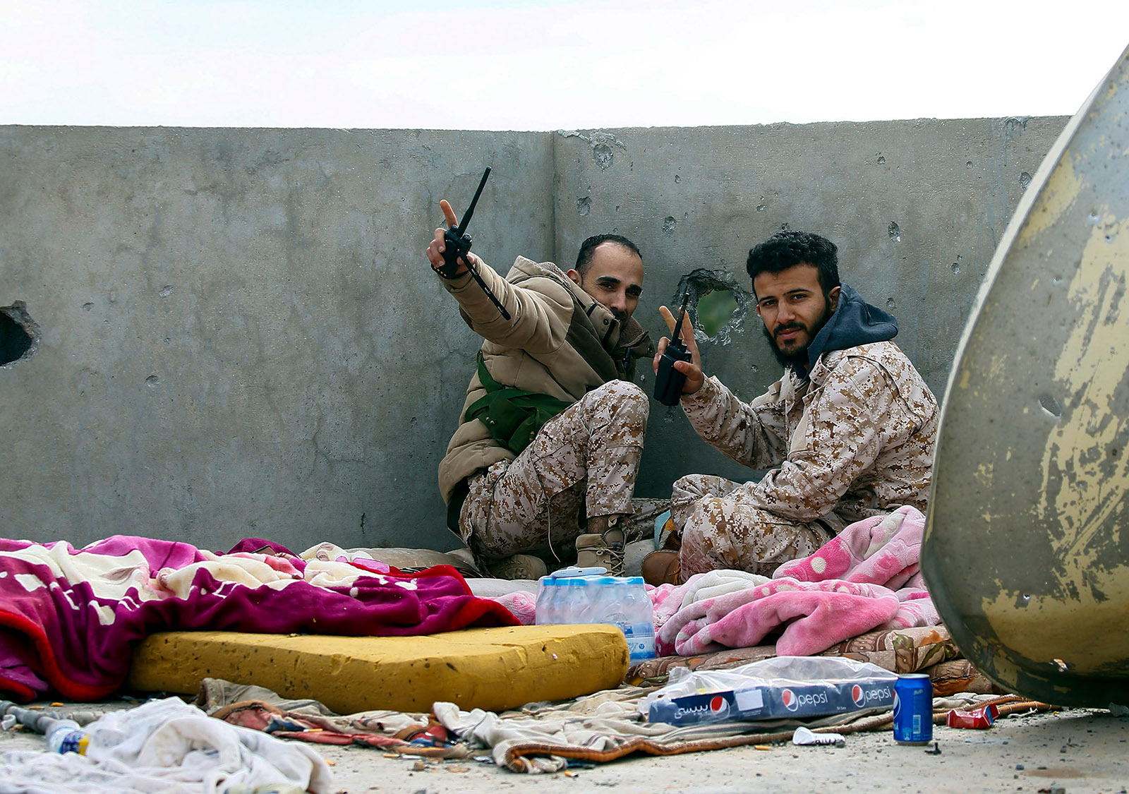 Libyan fighters at a lookout post near Tripoli