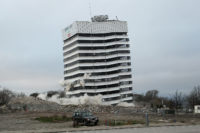 An earthquake-damaged building is demolished by controlled explosions, Christchurch, New Zealand, August 5, 2012