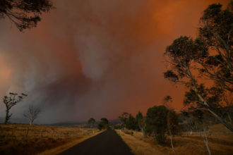Ember and thick smoke from bushfires, Braemar Bay, New South Wales, Australia, January 4, 2020