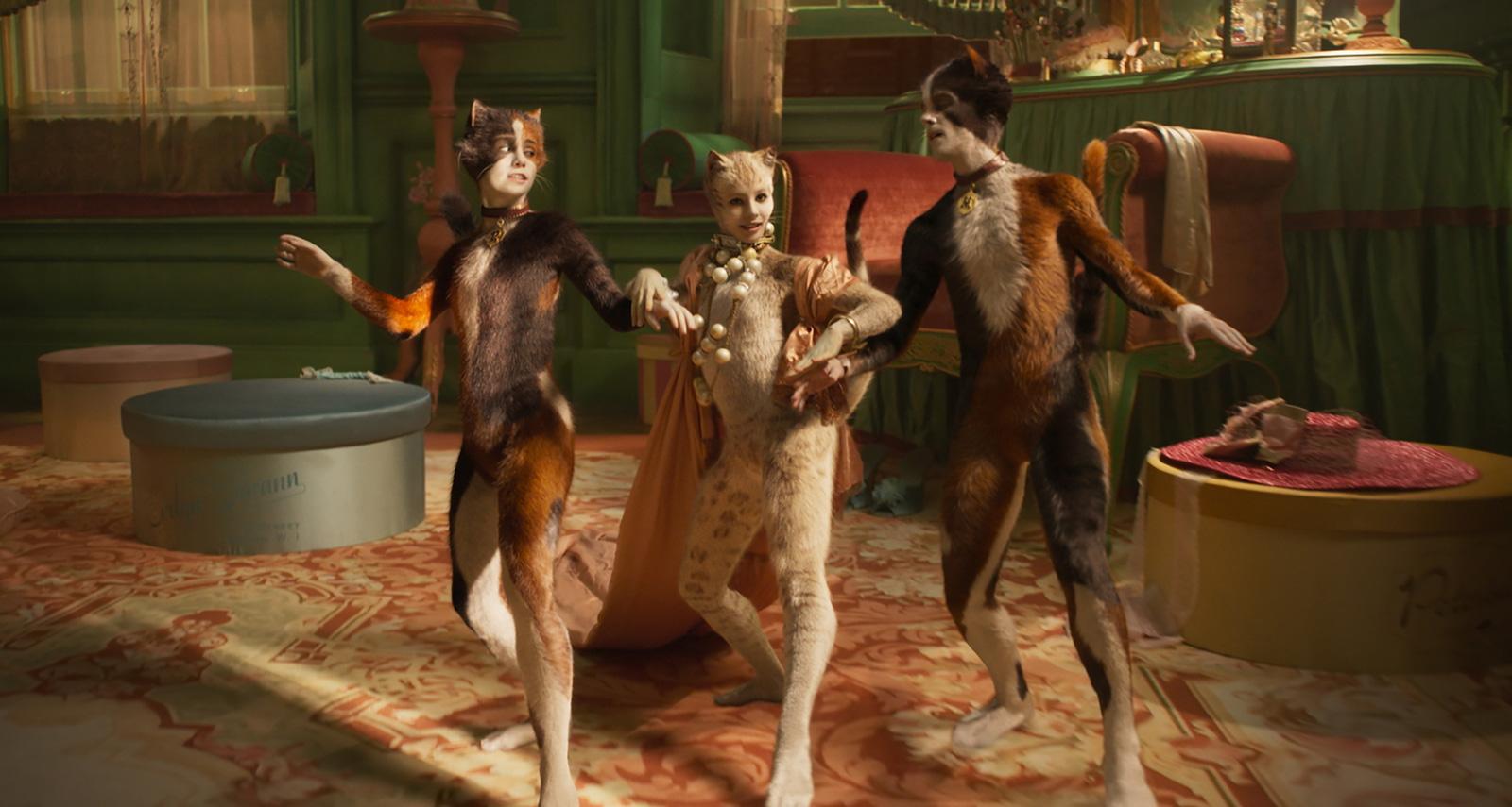 Naoimh Morgan as Rumpleteazer, Francesca Hayward as Victoria, and Danny Collins as Mungojerrie in Tom Hooper's Cats, 2019