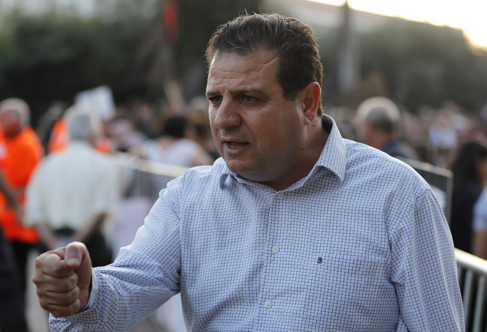 Ayman Odeh speaking at a protest