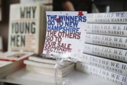 A book stall sign at a store in Des Moines, Iowa, the day of the Iowa caucuses, February 3, 2020