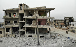 Ruined buildings in the village of Ma'arrat al-Nu'man after a weekslong regime offensive against rebel-held areas in Syria's Idlib province, February 12, 2020
