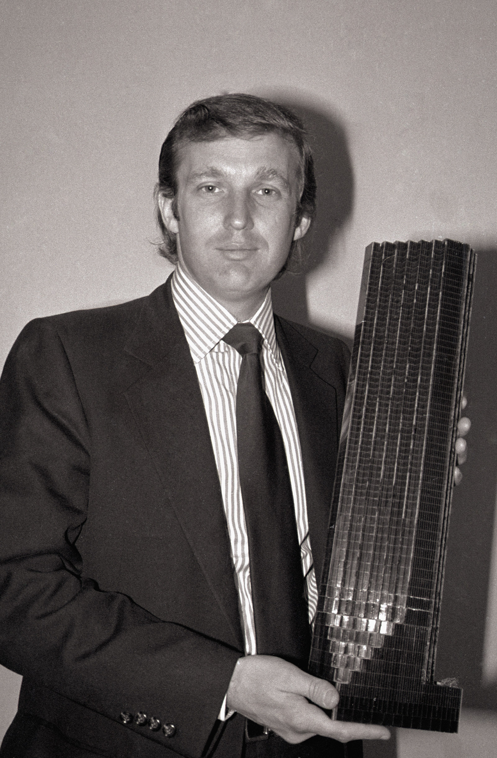 Donald Trump holding model of tower