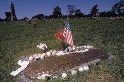 "Fans' mementos adorning the grave of Chicago White Sox player ""Shoeless"" Joe Jackson at Woodlawn Memorial Park, Greenville, South Carolina, 2003"