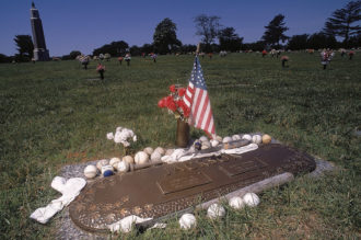 "Fans' mementos adorning the grave of Chicago White Sox player ""Shoeless"" Joe Jackson at Woodlawn Memorial Park, Greenville, South Carolina, 2003"