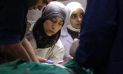 Two protagonists of the documentary The Cave, Dr. Amani and Dr. Alaa, working in their hospital operating room, Ghouta, Syria