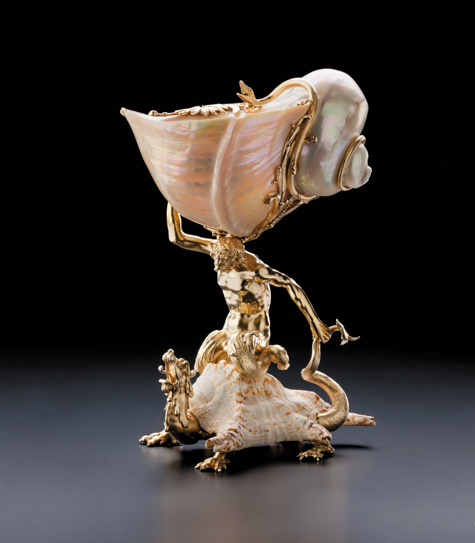 A turban-shell cup in the form of Triton riding a dragon, mid-seventeenth century