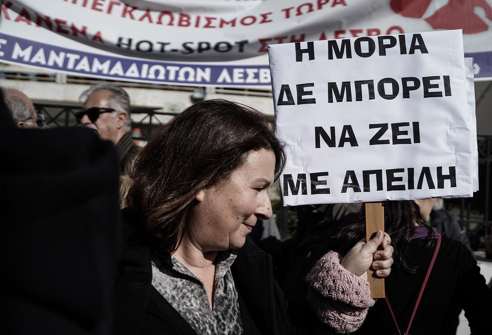 Greek woman protesting in Athens