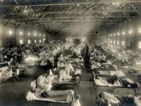 An improvised flu treatment ward at Camp Funston, Kansas, 1918