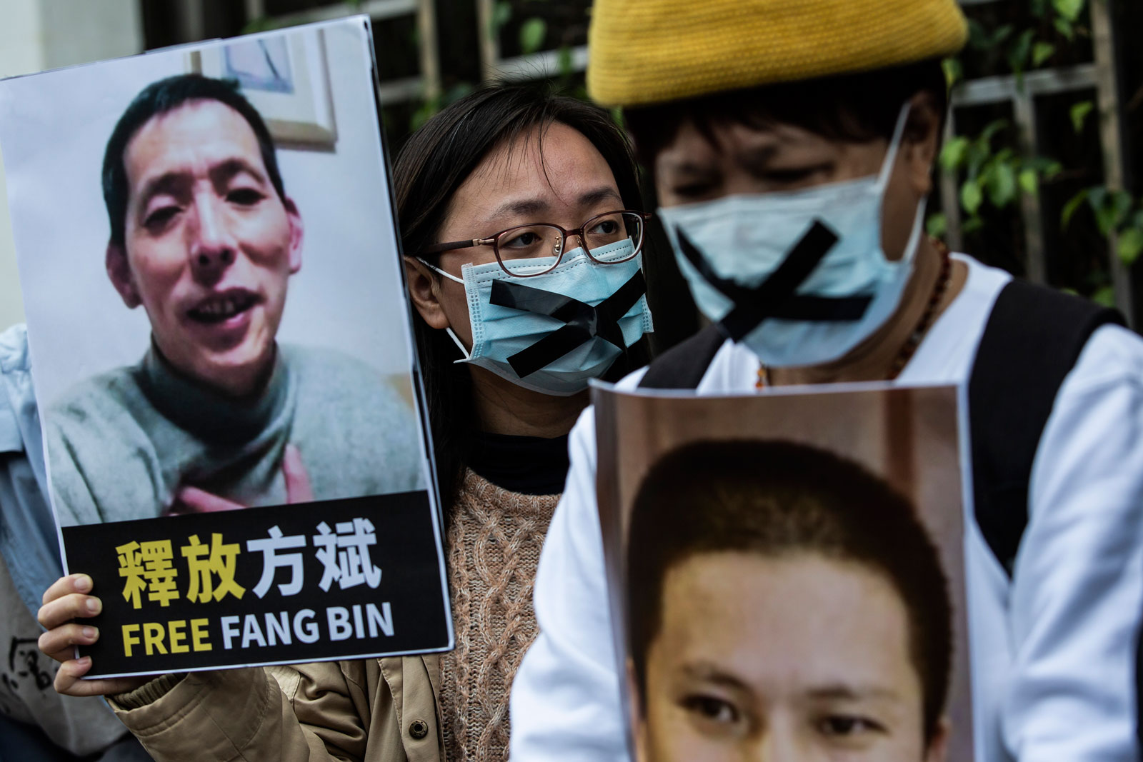 Pro-democracy activists holding pictures of missing citizen journalist Fang Bin and anti-corruption activistXu Zhiyong, who had been interrogating President Xi Jinping's handling of the Covid-19 crisis, at a protest outside the Chinese liaison office in Hong Kong, February 19, 2020