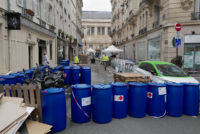 Pharmacists working on hand-sanitizer gel production next to a pharmacy in the Latin Quarter, Paris, France, March 29, 2020