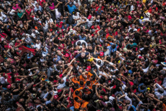 Former Brazilian president Luiz Inácio Lula da Silva with supporters on the day he agreed to start a prison sentence for corruption, São Paulo, April 2018; from Petra Costa's The Edge of Democracy