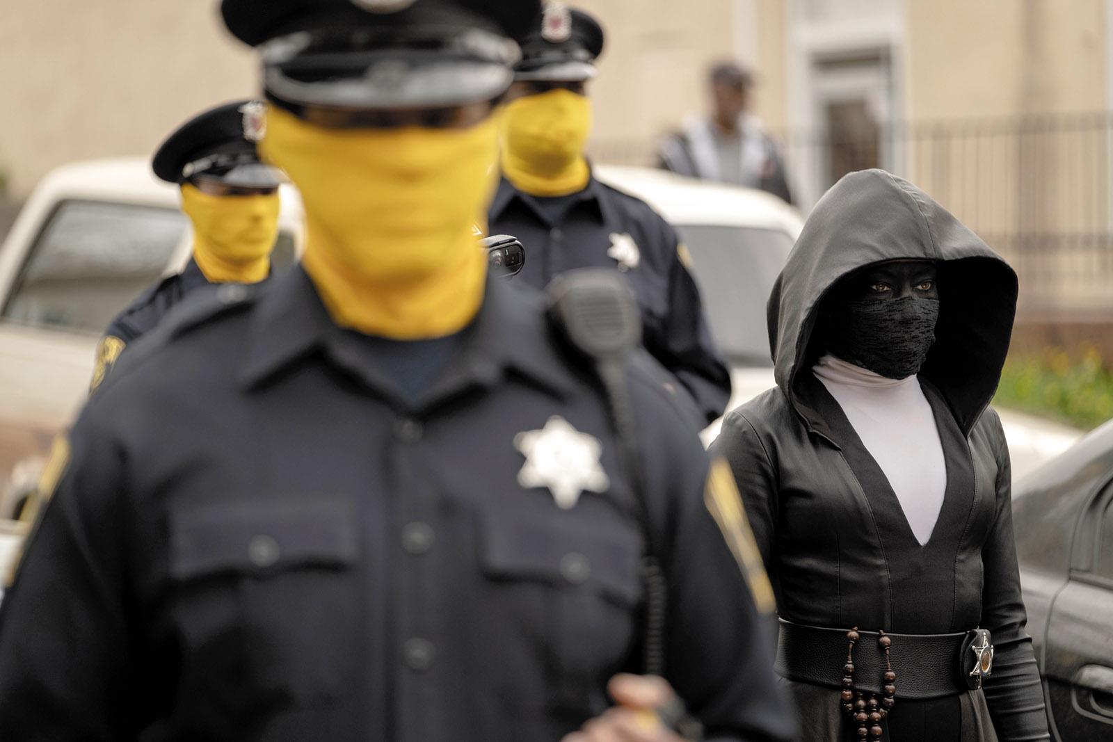 Regina King as Angela Abar in her Sister Night costume in Watchmen