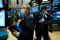 Traders working on the floor of the New York Stock Exchange just before trading went electronic, New York City, March 20, 2020
