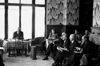 The first meeting of the Mont Pelerin Society with founding members Friedrich Hayek (left, at desk) and Ludwig von Mises (front row, second from right), Mont Pèlerin, Switzerland, 1947