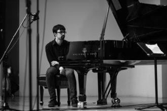 Micah Thomas at the piano, 2020