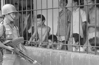 Suspected communists under armed guard, Jakarta, Indonesia, December 1, 1965