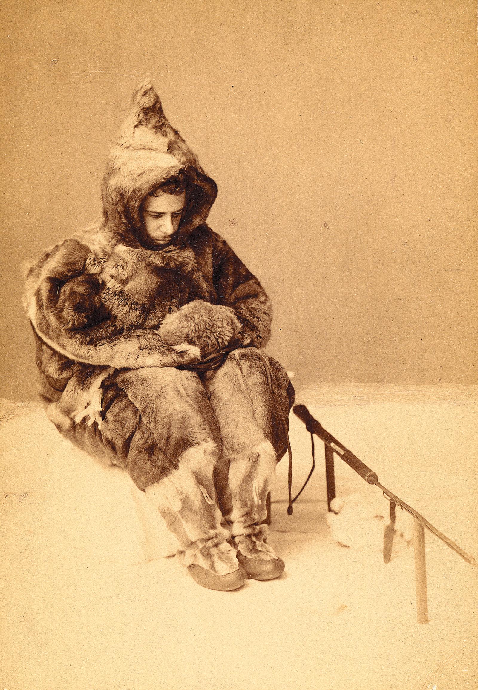 Franz Boas posing in Inuit garments