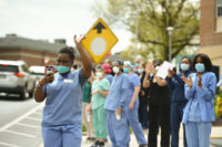 ManorCare workers gathering as people parade past the retirement facility where they work to thank them, West Reading, Pennsylvania, May 5, 2020