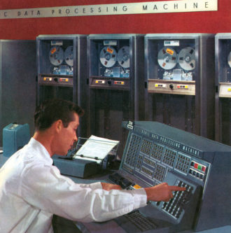 An illustration showing a computer technician operating an early data processing machine, 1950s