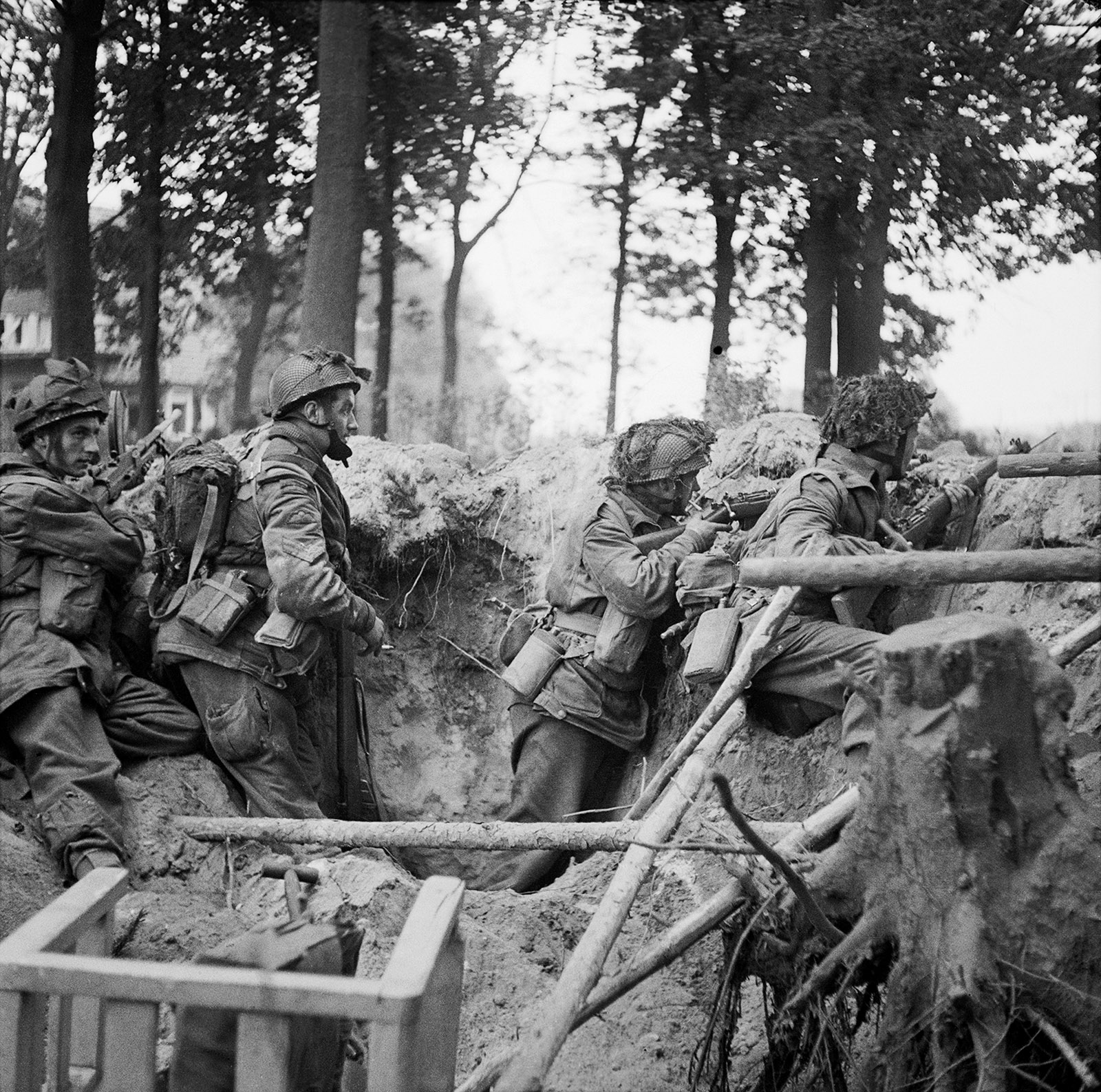 British soldiers taking cover in a shell hole near Arnhem, the Netherlands, September 17, 1944