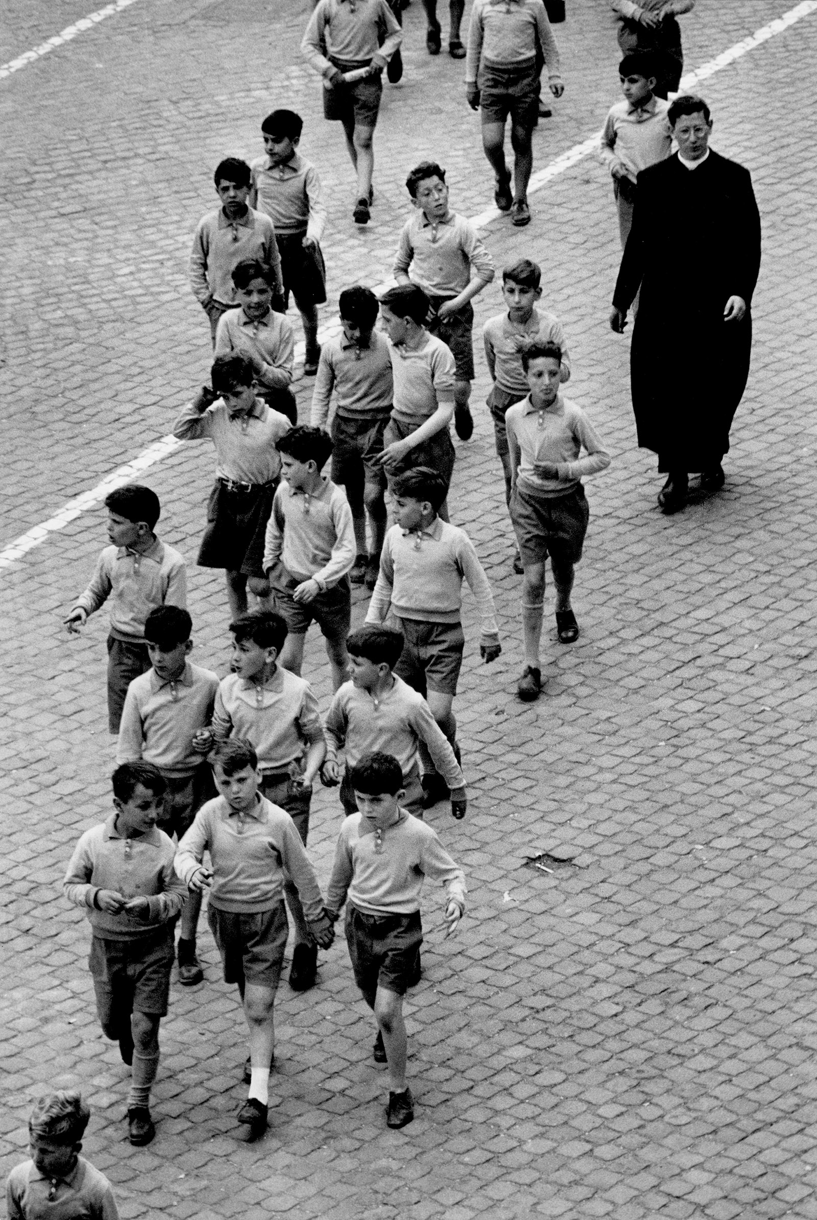 Students from a boys' school with a priest, Rome, 1953