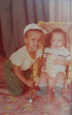 The author as a boy in Mogadishu, with his infant brother, Somalia, late 1980s
