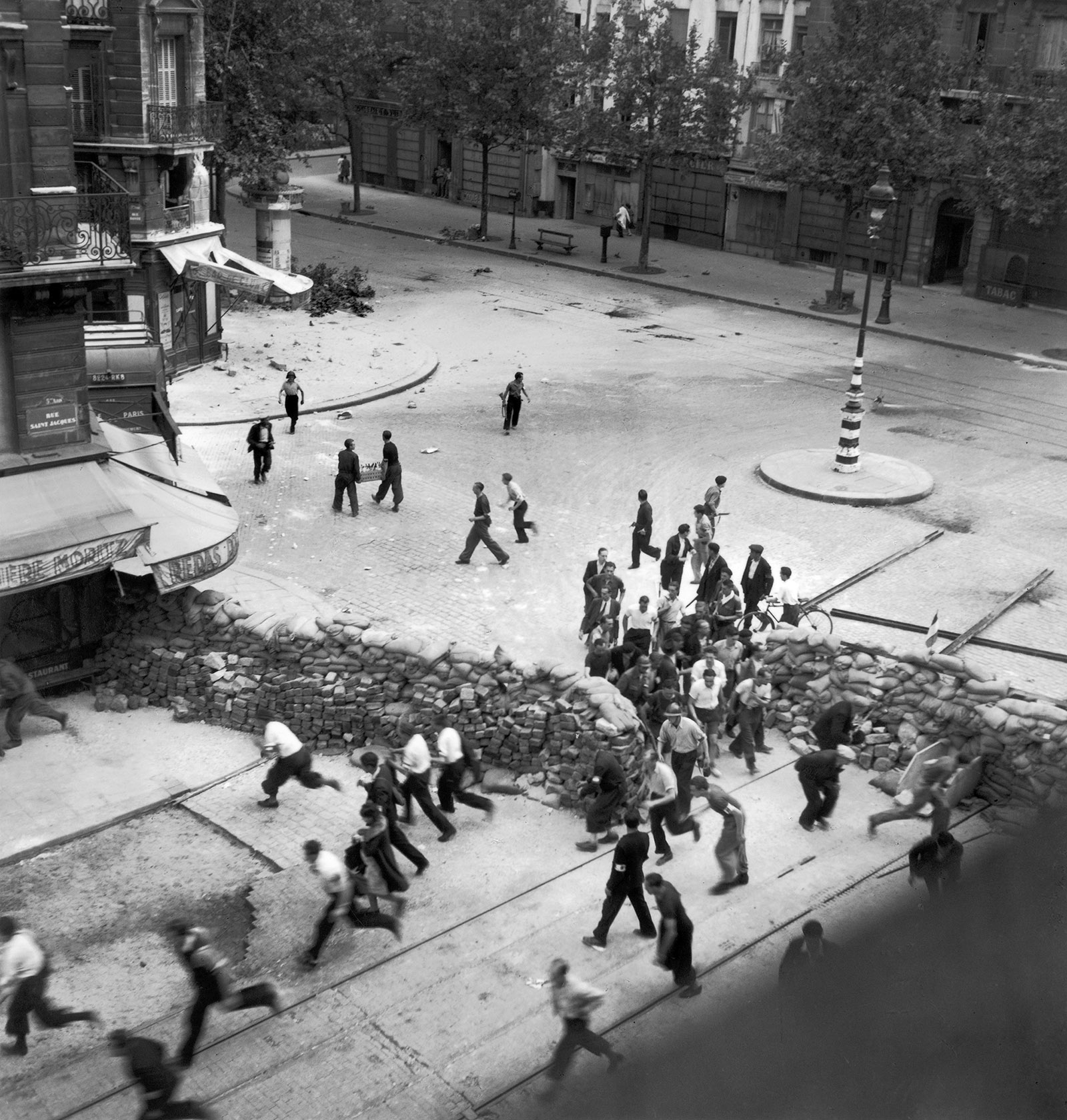 The French resistance erecting barriers in Paris to obstruct the German military as Allied forces approached the city