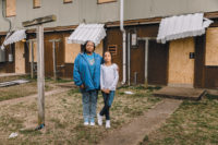 Terri Childs and her daughter Miracle in front of their apartment in the McBride housing project, shortly before it was closed and then demolished, Cairo, Illinois, 2018