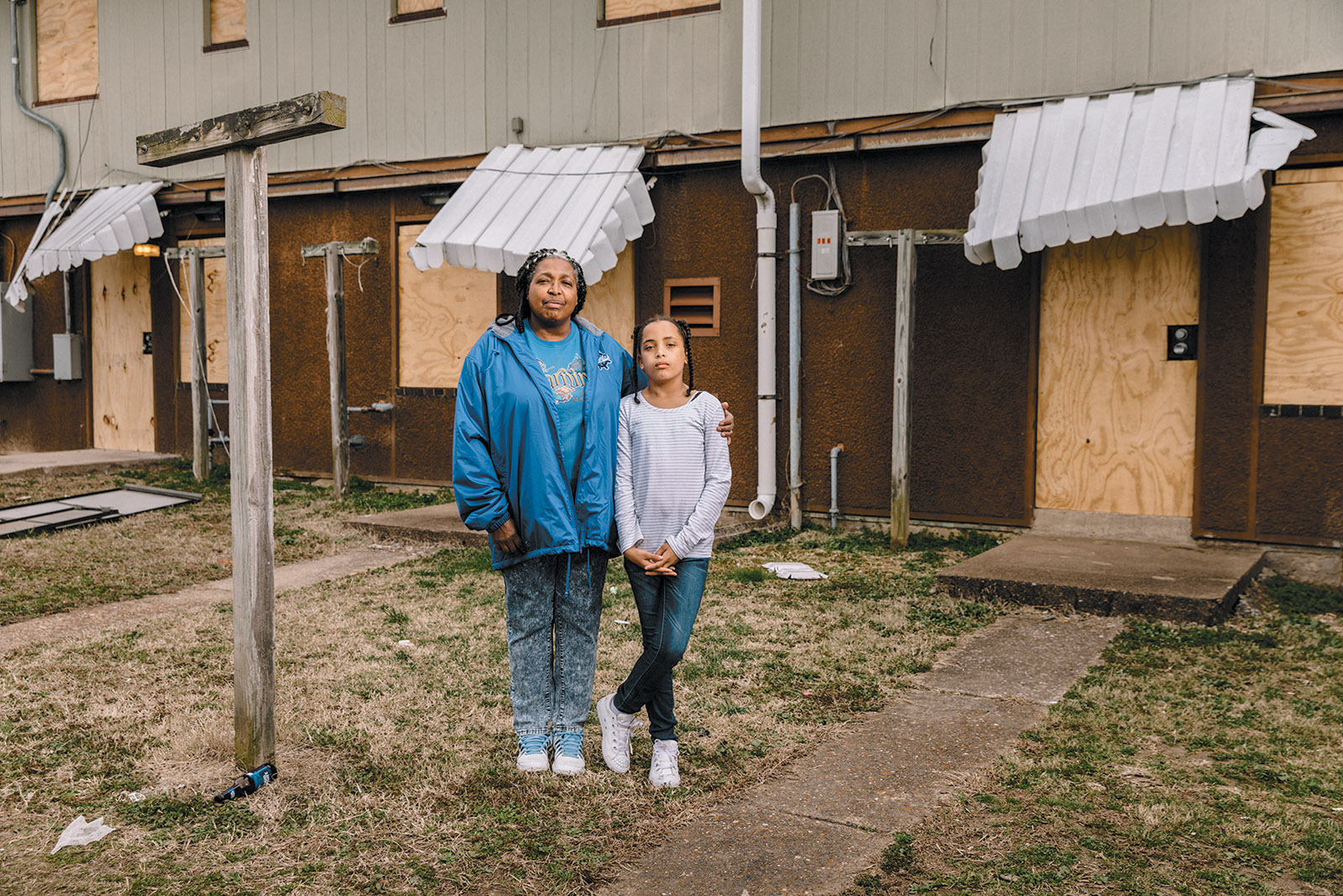 Terri Childs and her daughter Miracle in front of their apartment in the McBride housing project