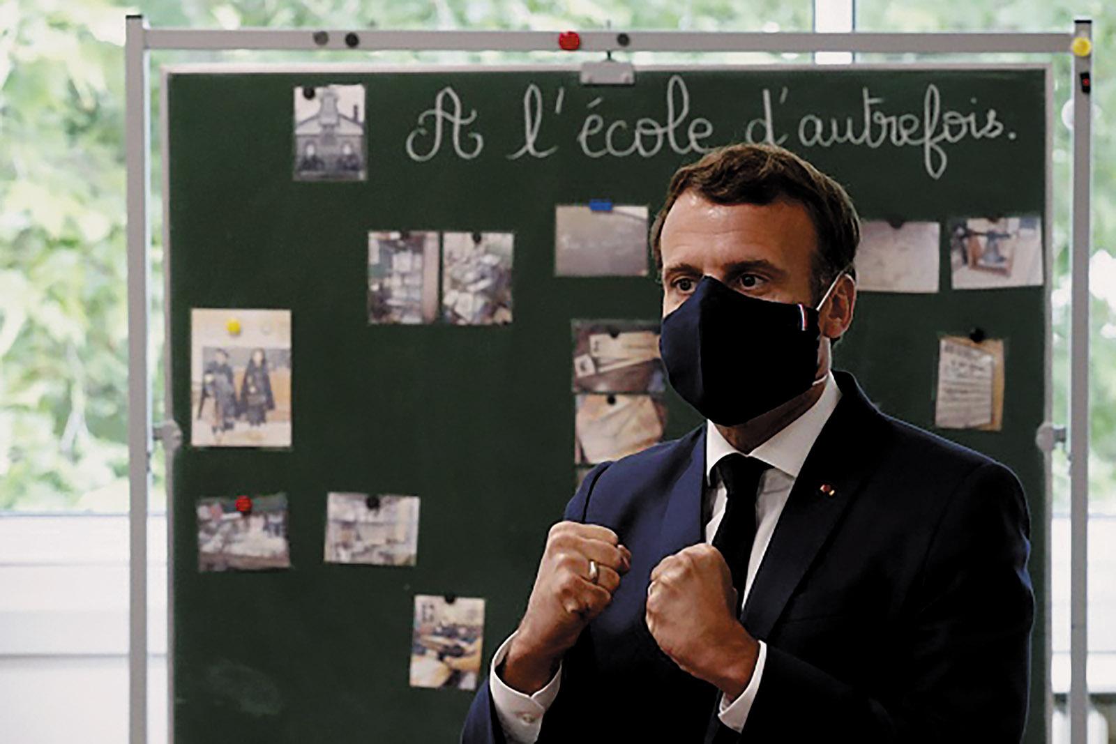 Emmanuel Macron visiting a French elementary school