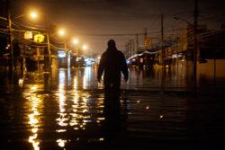 A man wading through flood waters on Hylan Boulevard in Staten Island, New York, October 30, 2012