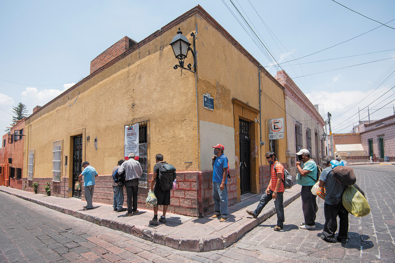 People lining up to receive free food during the coronavirus pandemic, Querétaro, Mexico