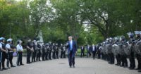 Donald Trump walking past riot police in Lafayette Park during protests following the police killing of George Floyd, Washington, D.C., June 2020