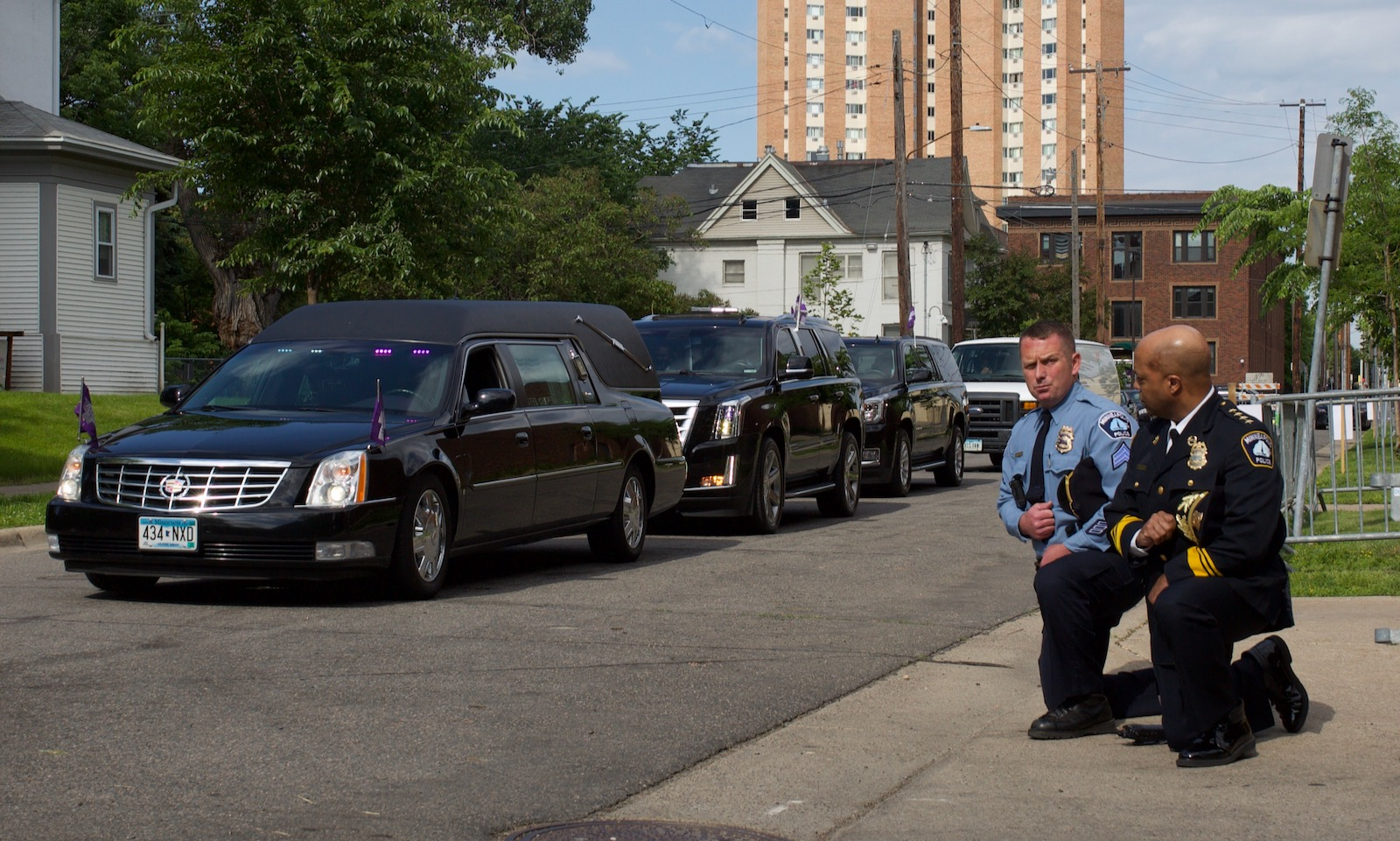 Minneapolis Police Chief Medaria Arradondo, accompanied by a MPD sergeant, taking a knee as the remains of George Floyd are driven to a memorial service in his honor, Minneapolis, Minnesota, June 4, 2020