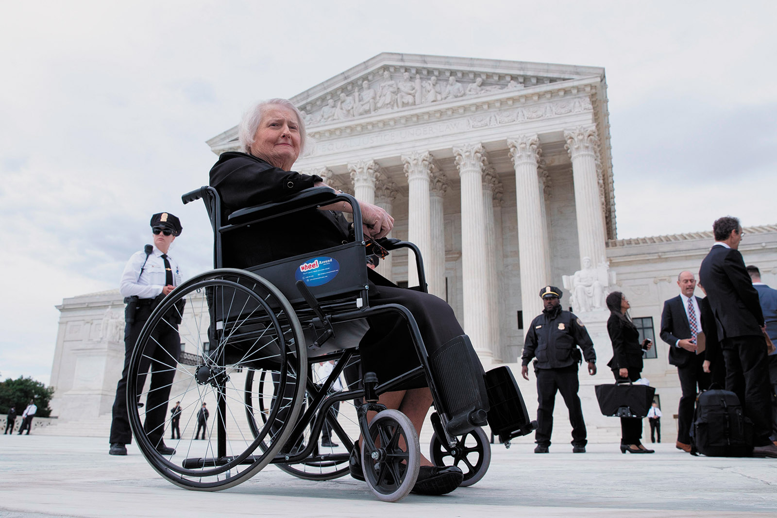 Aimee Stephens outside the Supreme Court after oral arguments by David Cole in her case challenging the legality of discrimination against transgender employees, Washington, D.C., October 2019. Stephens died in May.
