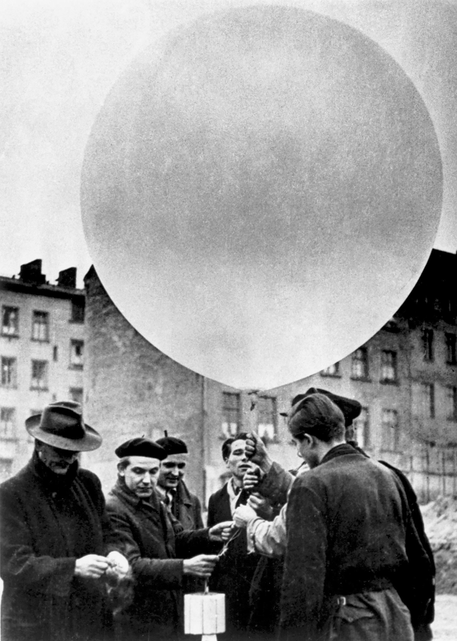 Members of a CIA-sponsored West German group using a weather balloon to deliver leaflets to East Germany, early 1950s