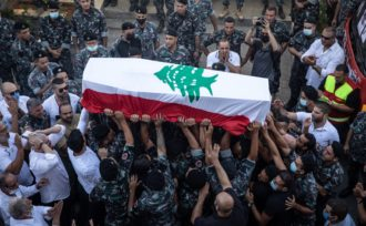 The coffin of firefighter Ralph Malahi, who was killed in the August 4 explosion, being carried to his funeral by friends and colleagues from the Karantina Fire Department, Beirut, Lebanon, August 15, 2020