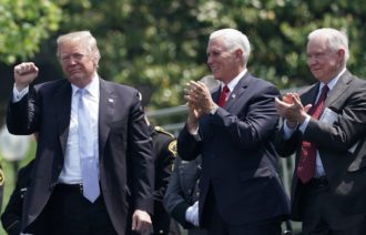President Donald Trump, applauded by Vice President Mike Pence and Attorney General Jeff Sessions, attending the Peace Officers' Memorial Service at the Capitol, Washington, D.C., May 15, 2018