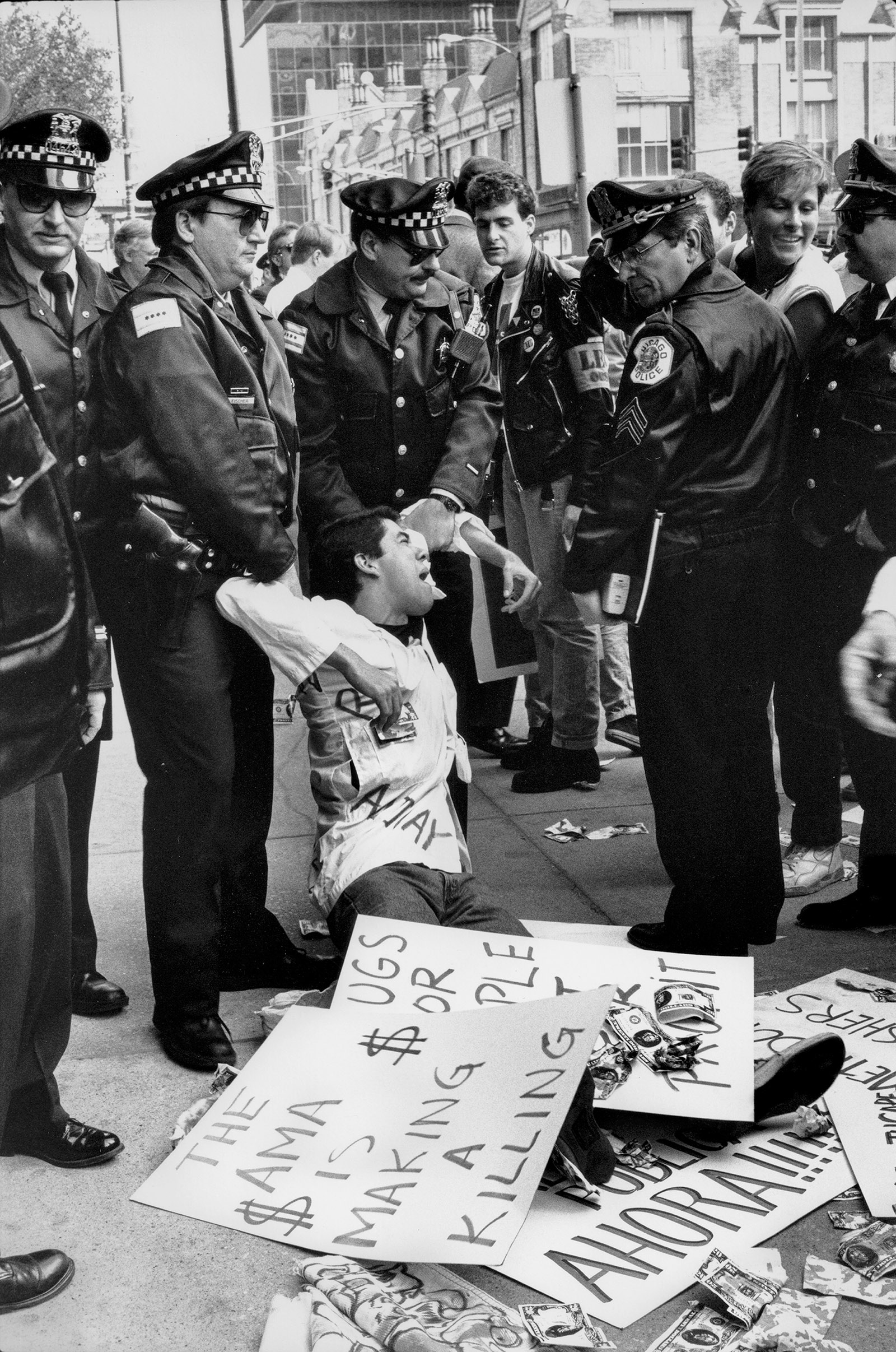 An ACT UP activist being arrested during an AIDS demonstration outside the headquarters of the American Medical Association, Chicago, April 1990