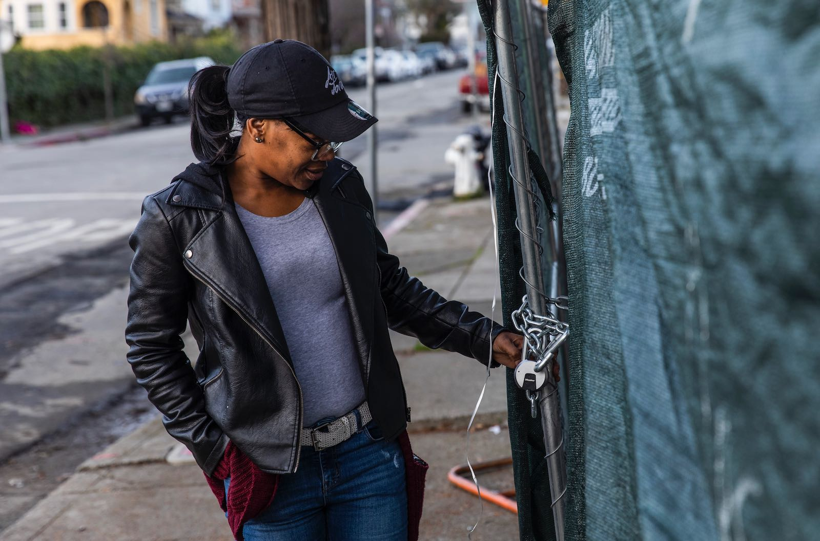 Moms 4 Housing activist Misty Cross surveying the fencing outside the home she was evicted from