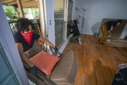 Housing activists breaking in to restore Kaotar Dee to her home of twenty-one years after she was locked out by her landlord, who had the LAPD board up the house, Los Angeles, California, May 29, 2020