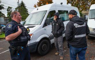 Eugene Police officer Bo Rankin talking with CAHOOTS coordinator Ben Brubaker and emergency crisis worker Matt Eads, Eugene, Oregon, October 2019