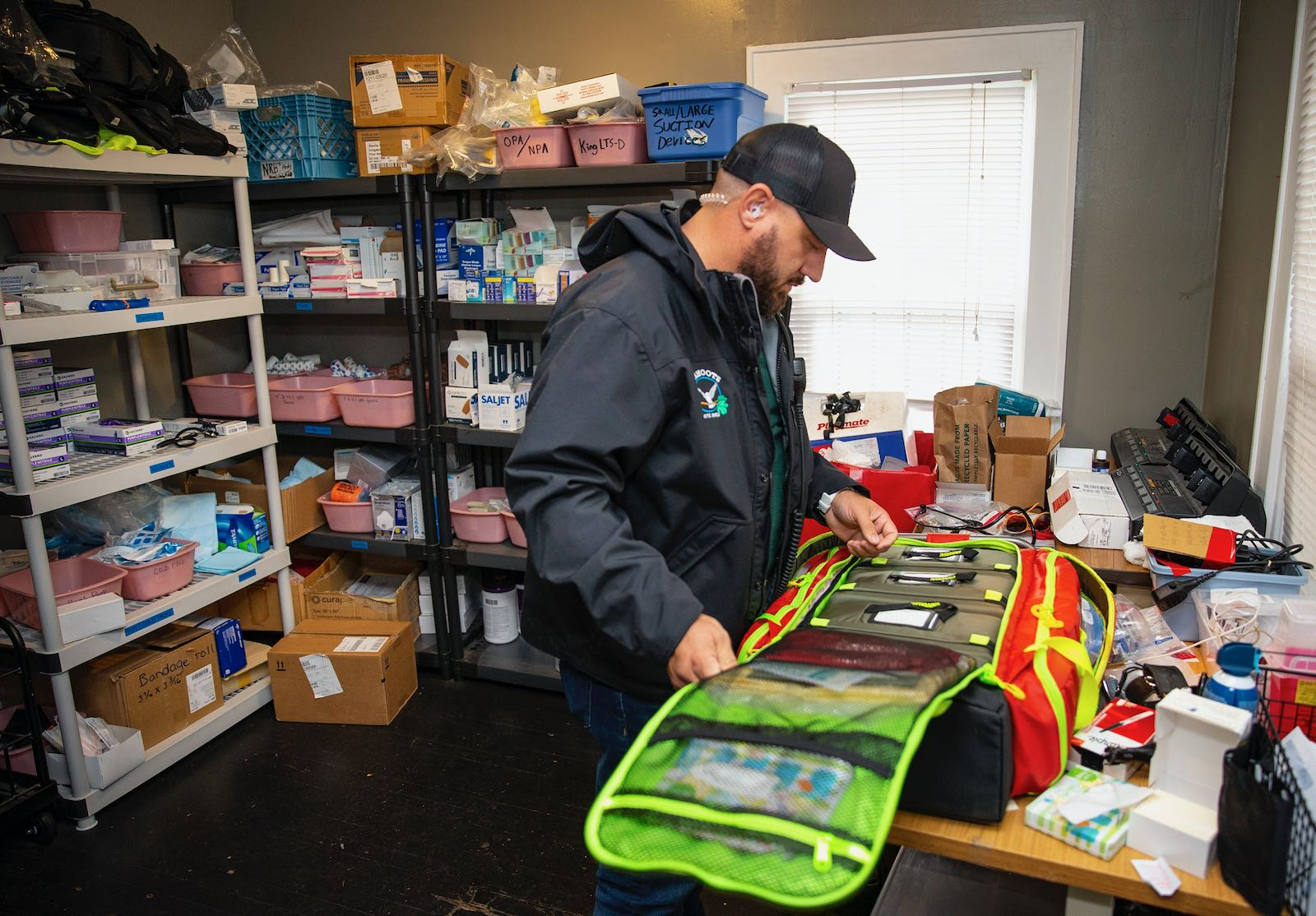 A emergency worker checks his medical kit, Eugene, Oregon